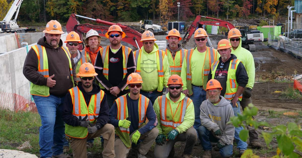 construction employees posing together