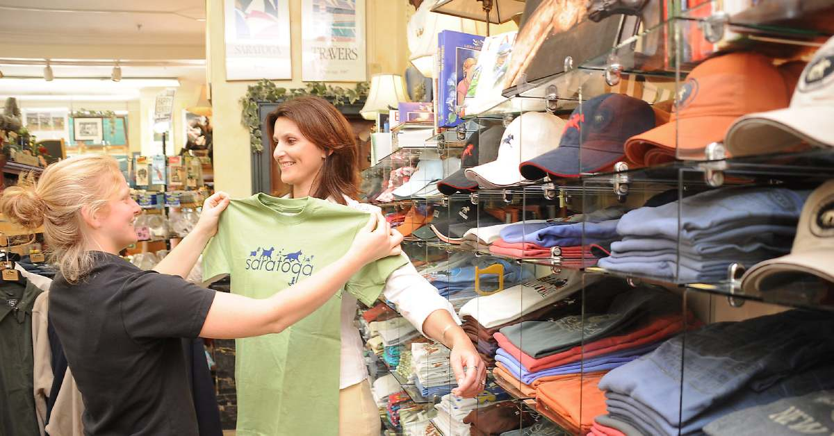 two women shopping for saratoga shirts at impressions