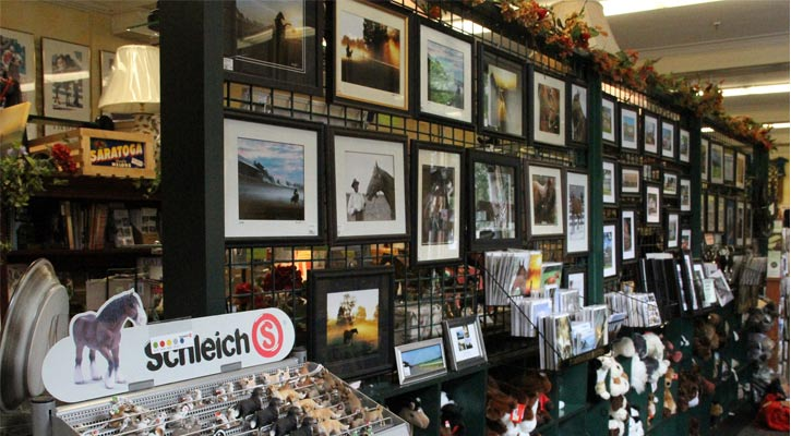 a line up of paintings and other merchandise at a store