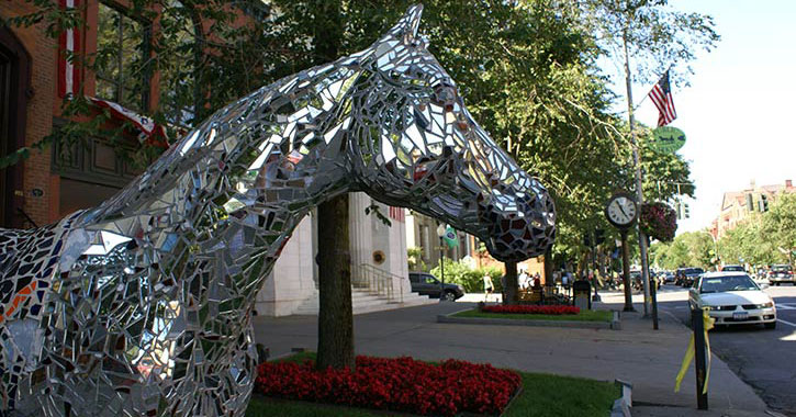 a silver statue of a horse