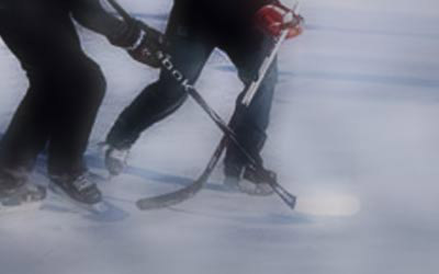 hockey players fight for the puck on the ice