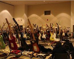 racks of guitars at the Saratoga Guitar Show