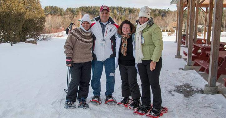 four snowshoers