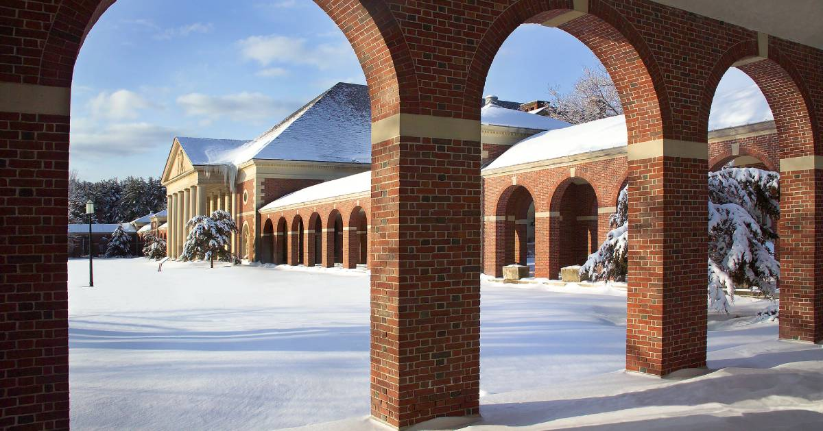 view of brick buildings and snowy ground