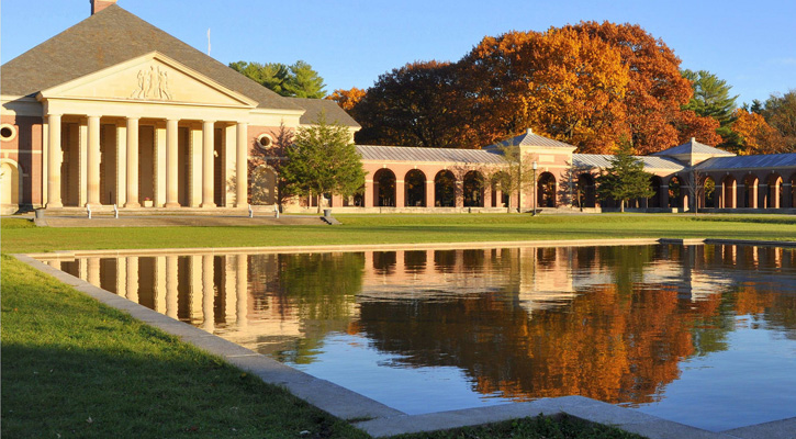 a large pool in front of a building in Saratoga Spa State Park with fall foliage