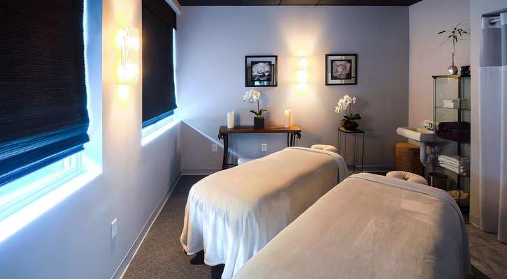 two massage beds in a spa in a tranquil looking room