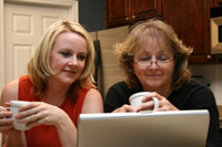mother and daughter searching the internet