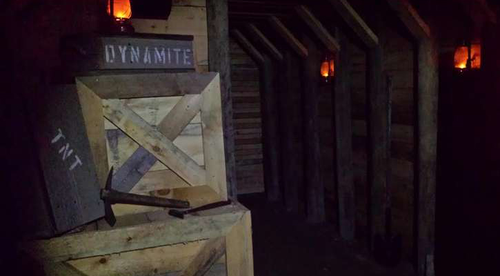 a creepy dark room with a box that says dynamite