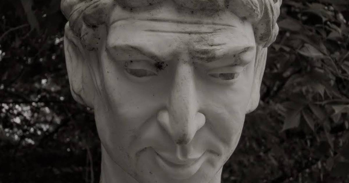 black and white photo of statue, close up of face