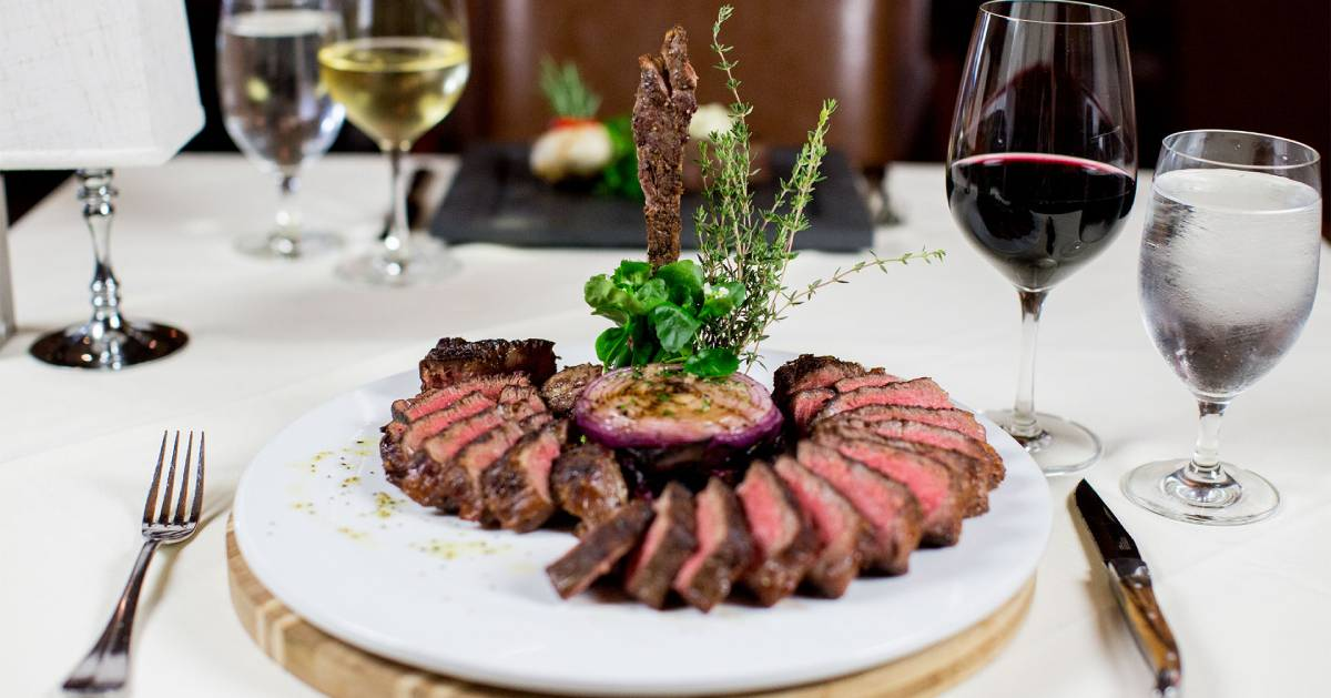 artfully plated steak with red wine