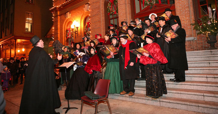 carolers singing on steps at night