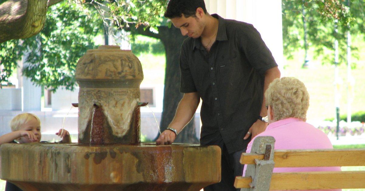 man and kid at mineral spring