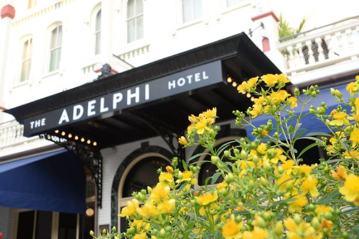 flowers in front of the adelphi hotel's entrance