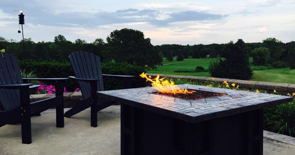 chairs by table with fire pit