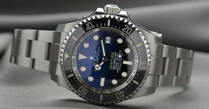 a silver Rolex watch
