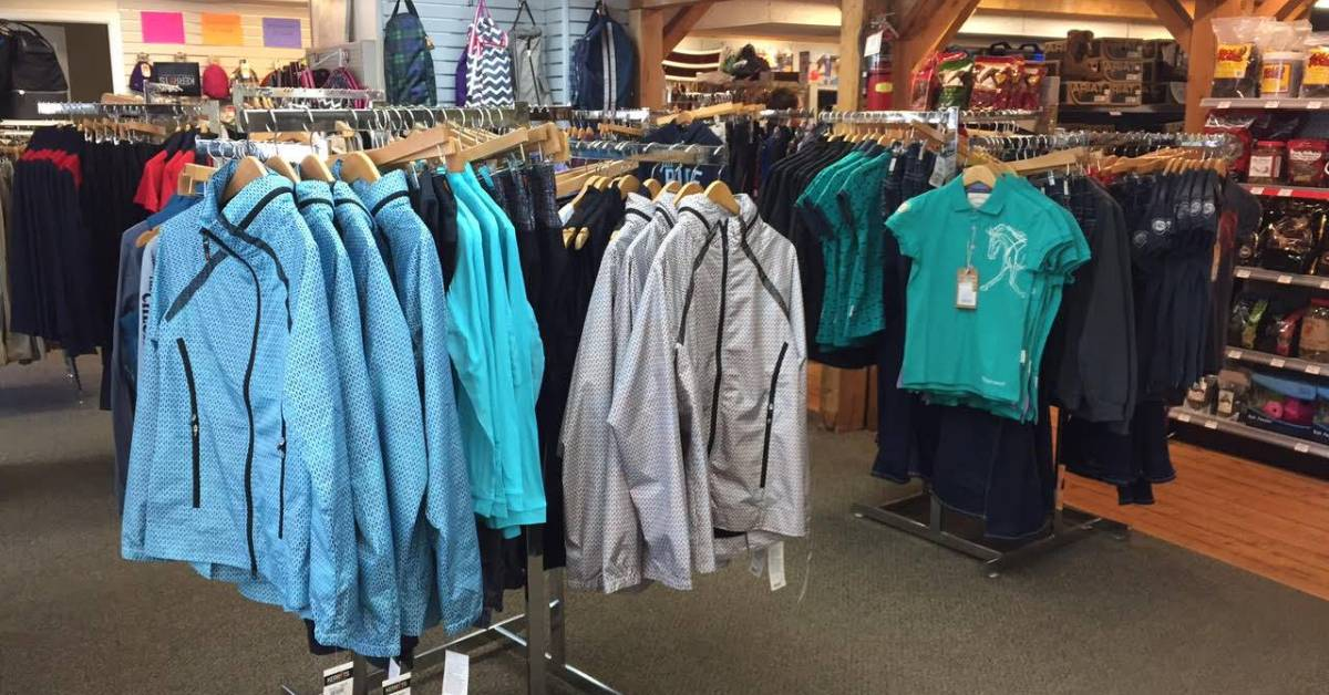 jackets and shirts on display in a store