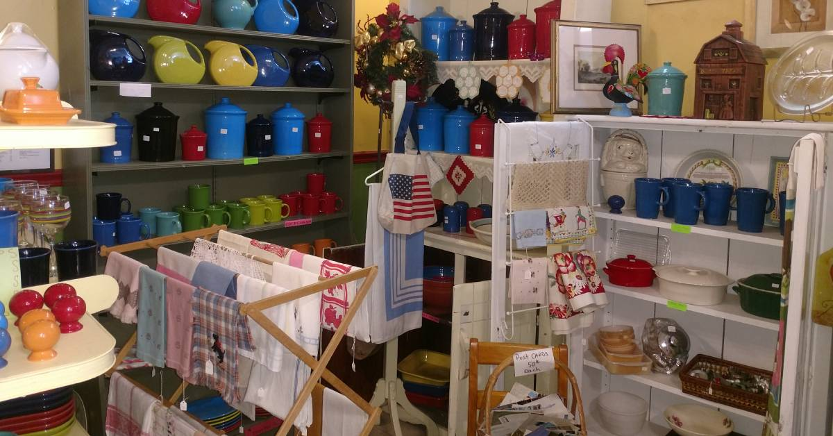 antique store with colorful kitchenware, linens, and more