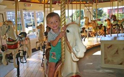 little boy on horse on carousel