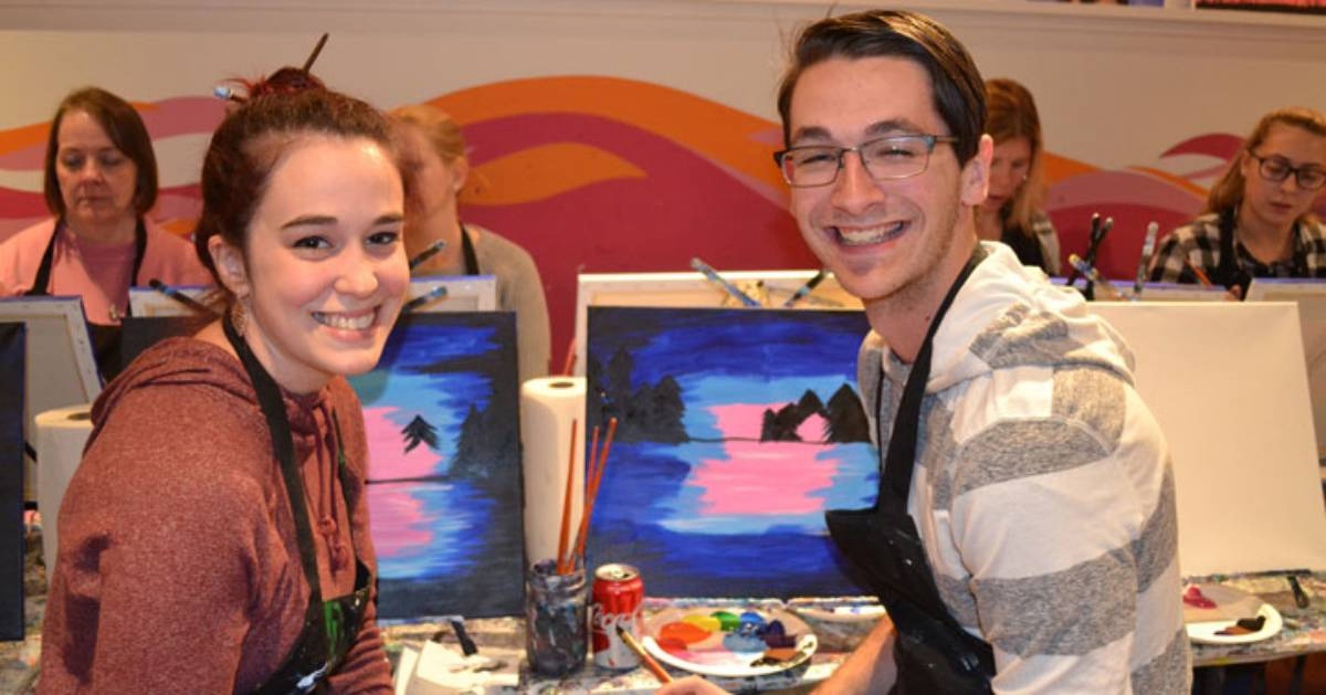 man and woman at paint and sip table