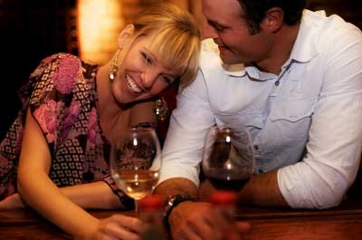 couple laughing over wine