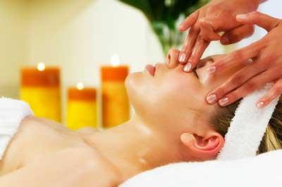 a woman getting a facial massage