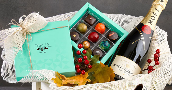 a gift basket with chocolate and wine in it