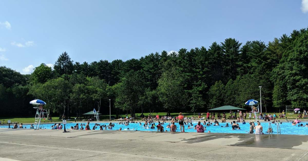 people in an outdoor swimming pool