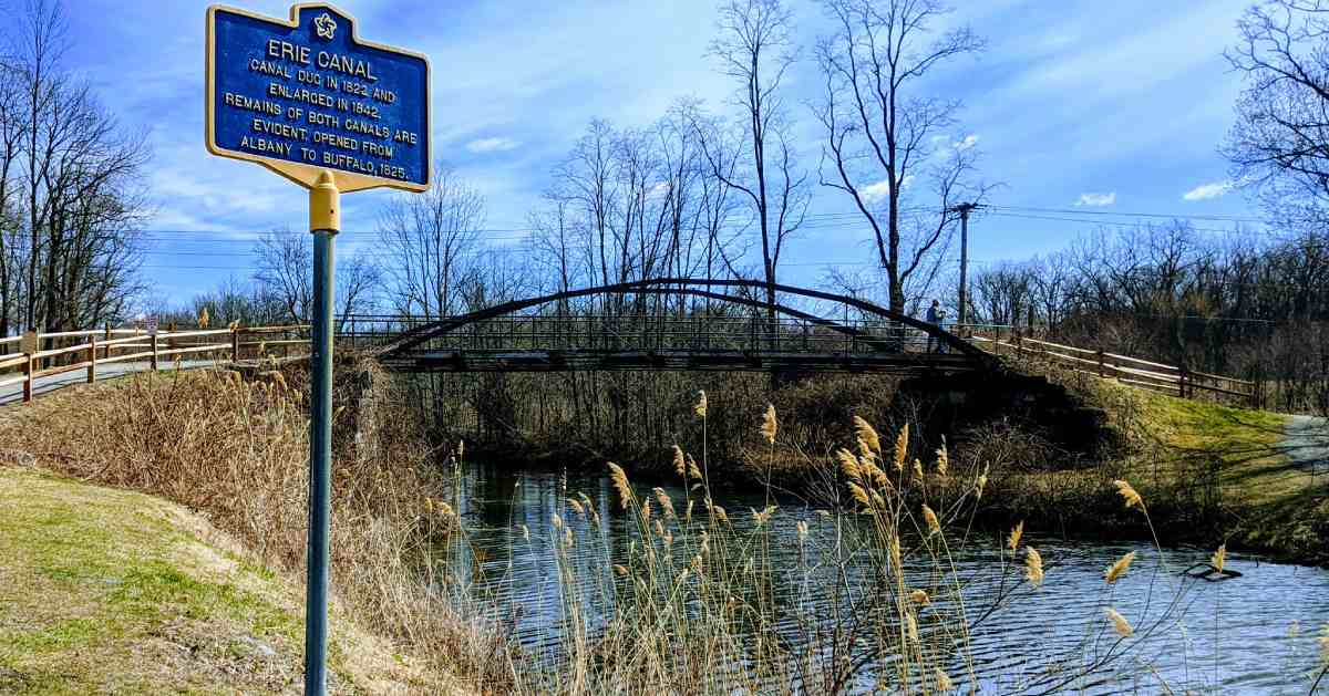 erie canal sign and a bridge