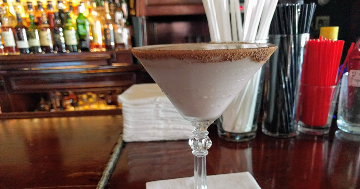 what looks like a chocolate martini on a bar