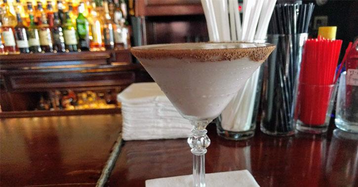 what looks like a chocolate martini on a bar