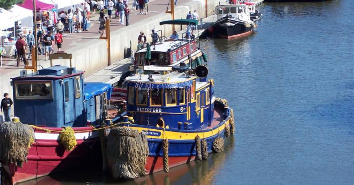 canal boats near shore at festival