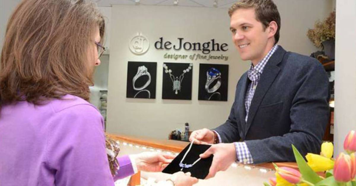 male salesman and woman at jewelry store counter
