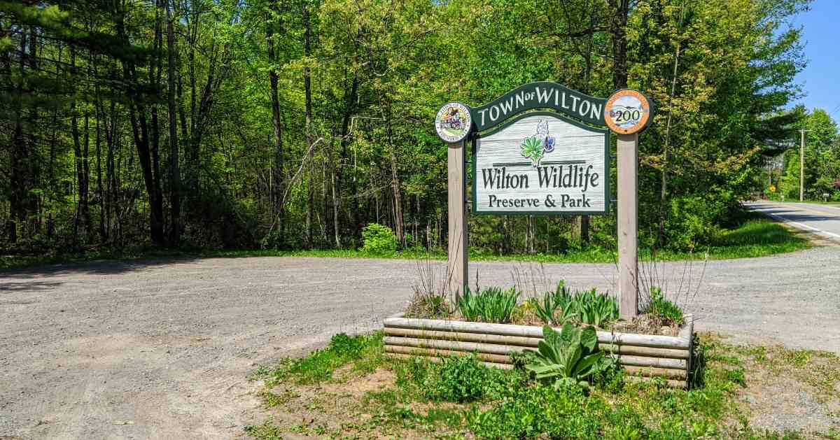 entrance sign for wilton wildlife preserve and park