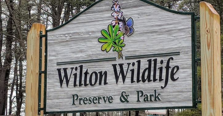 a sign for Wilton Wildlife Preserve