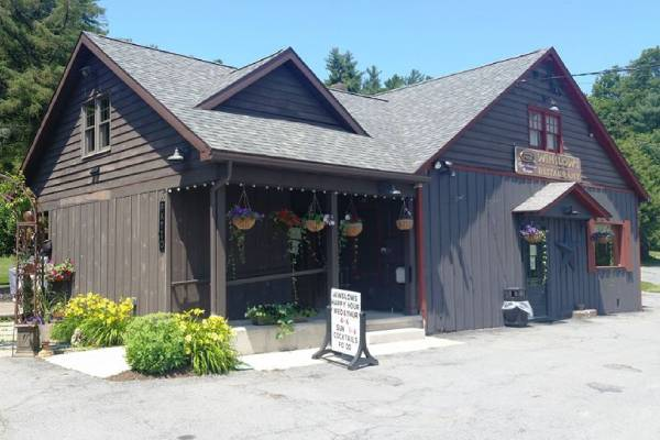 outside dark wooden restaurant building