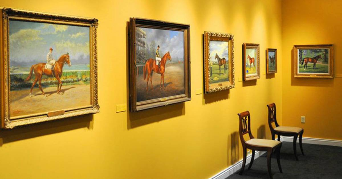 yellow walls with paintings of horses on them