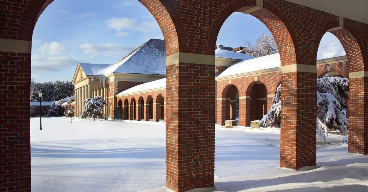 brick building and snow on the ground