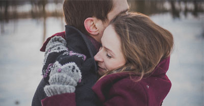 a couple embracing outside in the winter