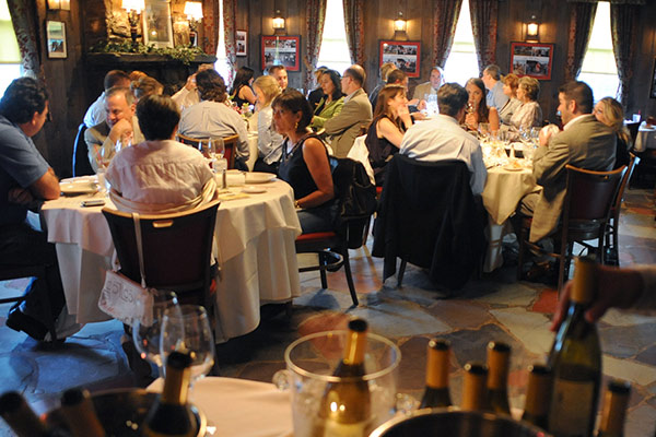 multiple tables of people dining at the wishing well