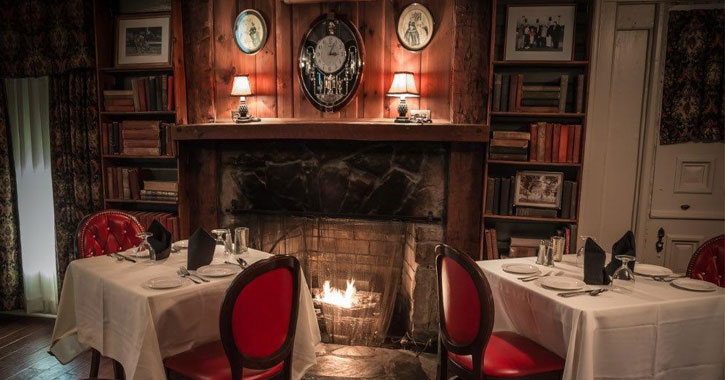 a roaring fireplace in an elegant restaurant