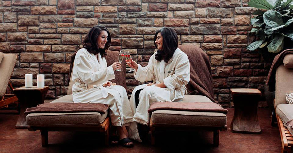 women in a spa cheersing with drinks