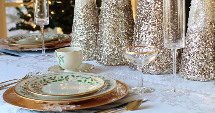 a set table decorated for Christmas