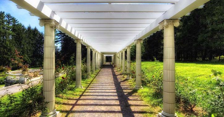 a symmetrical walkway in Yaddo Gardens class=