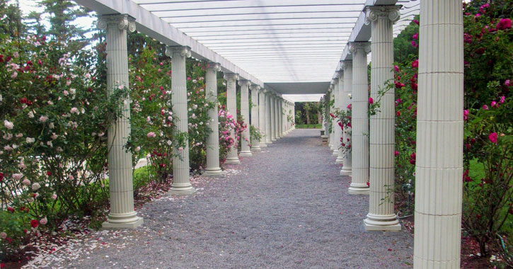 a pathway with columns through Yaddo Gardens