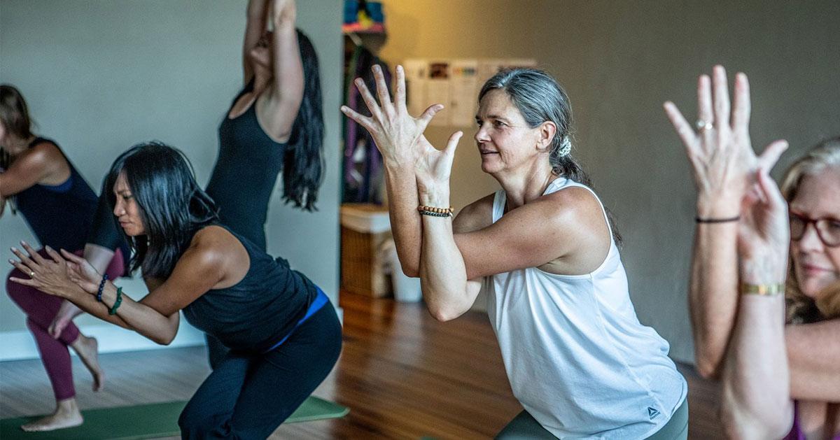 women donig yoga, eagle pose