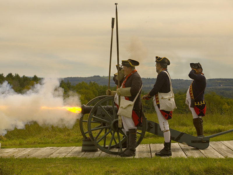 Revolutionary War Reenactors firing a cannon at Saratoga Battlefield