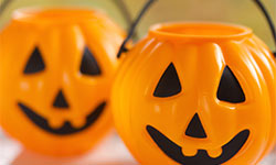 two jack-o-lantern buckets for trick-or-treating