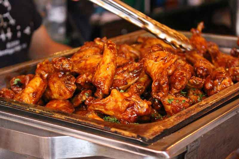 Hotel pan full of chicken wings from Bailey's Cafe