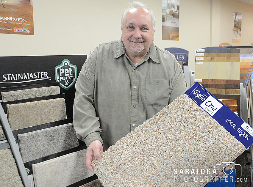 Paul Mastroieni was working in the financial field after giving up a six-store group of flooring outlets. He has left that field and opened the Floor Store in the Shops of Malta. ©2016 Saratoga Photographer.com