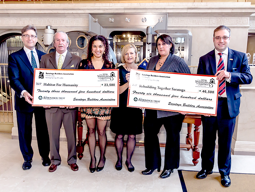 Members of the Saratoga Builders Association present checks to Rebuilding Together Saratoga County and Habitat for Humanity of Northern Saratoga, Warren and Washington Counties. Courtesy Showcase of Homes
